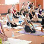 Yogis in Bikram Yoga class at Coachella Yoga